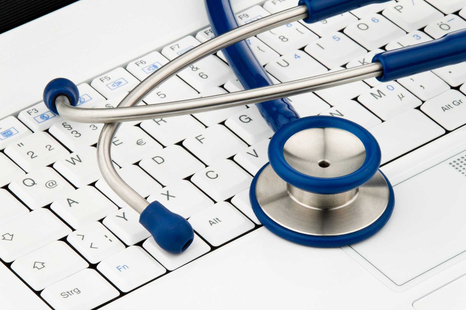 Stethoscope on laptop computer. Security for data on the Internet. Horizontal.